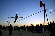 Rajasthan, India. A 12 years old girl is performing tightrope walking in front spectators at the Desert Festival in Jaisalmer.<br /> Photo by Lorenz Berna