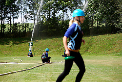 CZECH REPUBLIC VYSOCINA NEDVEZI 2AUG14 - Voluntary female firefighters perform during a race on the village common in Nedvezi, Vysocina, Czech Republic.<br /> <br /> .<br /> <br /> jre/Photo by Jiri Rezac<br /> <br /> <br /> <br /> © Jiri Rezac 2014