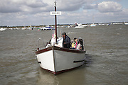 Passengers on ferry boat cross the River Deben between Bawdsey and Felixstowe Ferry, Suffolk, England