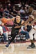 Pepperdine Waves guard Colbey Ross (4) dribbles by Southern California Trojans forward Onyeka Okongwu (21) during an NCAA college basketball game, Tuesday, Nov. 19, 2019, in Los Angeles. USC defeated Pepperdine 91-84. (Jon Endow/Image of Sport)