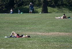© Licensed to London News Pictures. 23/04/2020. London, UK. People sunbathing in Primrose Hill, north London during a pandemic outbreak of the Coronavirus COVID-19 disease. The public have been told they can only leave their homes when absolutely essential, in an attempt to fight the spread of coronavirus COVID-19 disease. Photo credit: Ben Cawthra/LNP. Photo credit: Ben Cawthra/LNP