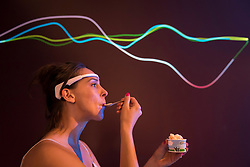 "© Licensed to London News Pictures. 03/07/2018. LONDON, UK. The brain waves of a staff member experiencing eating ice cream are seen at a preview of ""SCOOP: A Wonderful Ice Cream World"", the first official exhibition of the British Museum of Food.  The exhibition presents items from the Robin and Caroline Weir Collection and explores the science and appeal of ice cream going back 400 years.  The exhibition takes place at the Gasholders near Granary Square in Kings Cross and runs 3 July to 30 September 2018.  Photo credit: Stephen Chung/LNP"