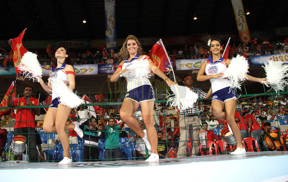 Cheerleaders during match 1 of the NOKIA Champions League T20 ( CLT20 )between the Royal Challengers Bangalore and the Warriors held at the  M.Chinnaswamy Stadium in Bangalore , Karnataka, India on the 23rd September 2011..Photo by Shaun Roy/BCCI/SPORTZPICS