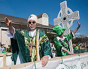 Richard Anderson blesses the crowds at the Dallas St. Patrick's Parade on Greenville Avenue, Saturday, March 16, 2013. (Cooper Neill/The Dallas Morning News)