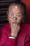 Elderly woman at Bodnath Stupa, Kathmandu.