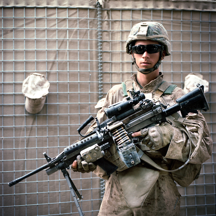 Location:<br /> Patrol Base Fires, Sangin District, Helmand Province, Afghanistan<br /> <br /> Unit: <br /> 3rd Squad, 1st Platoon, Bravo Company, 1st Battalion, 5th Marines<br /> <br /> Name and Rank: Lance Corporal Taylor &quot;Gecko&quot; Moody<br /> <br /> Age: 20<br /> <br /> Hometown: Watertown, New York<br /> <br /> Why did you join the Marine Corps?<br /> <br /> &quot;I joined the Marine Corps mainly because I didn&rsquo;t really think I had a choice. My grades weren&rsquo;t all that great and I wanted to join the military anyway, so I decided for the Corps.&quot;<br /> <br /> Describe Sangin for someone back home:<br /> <br /> &quot;When we first got here we were expecting sand, of course, like everyone expects sand in Afghanistan, and then we come here to the green zone. Like, we knew we were gonna come into something green, but we didn&rsquo;t understand how green it was gonna be. You know, the reeds now are twelve feet tall and there&rsquo;s bamboo that&rsquo;s even taller than that.&quot;<br /> <br /> What does rigorous patrolling do to your body?<br /> <br /> &quot;I didn&rsquo;t notice it at first, but, the other Marines in my squad noticed and in other squads noticed, I had lost a shit ton of weight, and you can see it yourself&mdash;I&rsquo;m extremely skinny&mdash;and I just kept losing more and more weight. <br /> <br /> So from a food perspective all I could do was think of food, and that&rsquo;s still all I do. On patrol, we&rsquo;ll take a quick break every now and then, you know post security, and I&rsquo;ll just be sitting there thinking 'God I&rsquo;m so fucking hungry.'&quot;<br /> <br /> What's it like to move through the terrain?<br /> <br /> &quot;Moving around is completely demoralizing sometimes, like, you won&rsquo;t even go through a canal sometimes and you&rsquo;ll just be drenched, and you&rsquo;ll know it&rsquo;s just your own juice . . . like I say, you&rsquo;re just drenched in your own juice, your own sweat.&quot;<br /> <br /> What do you think about the Taliban?<br /> <br /> &quot;Every now and then we&rsquo;ll hit one of them, but because they&rsquo;re so small and unnoticeable, you know, they blend into the environment, they blend into all the other locals, everyone pretty much looks the same to us, that we can&rsquo;t really . . . we don&rsquo;t have a