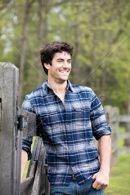 good looking man smiling outdoors