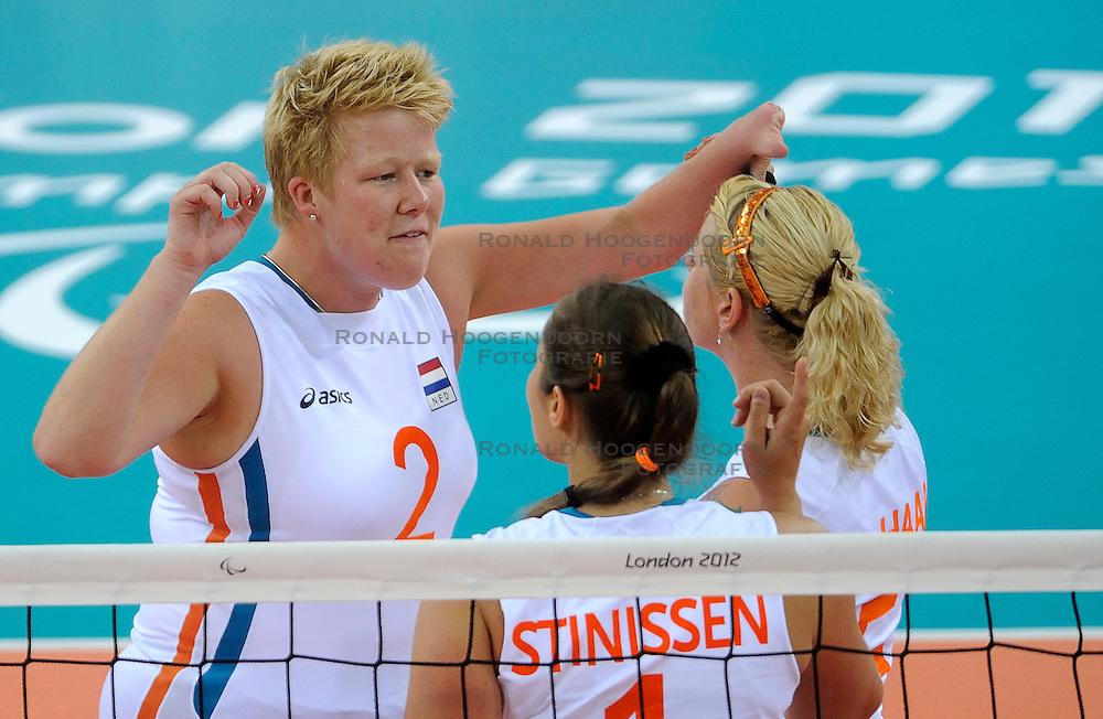 01-09-2012 ZITVOLLEYBAL: PARALYMPISCHE SPELEN 2012 ENGELAND - NEDERLAND: LONDEN<br /> In ExCel South Arena wint Nederland ook de tweede wedstrijd. Engeland werd met 3-0 verslagen / Marieke de Ruijter, Elvira Stinissen<br /> &copy;2012-FotoHoogendoorn.nl