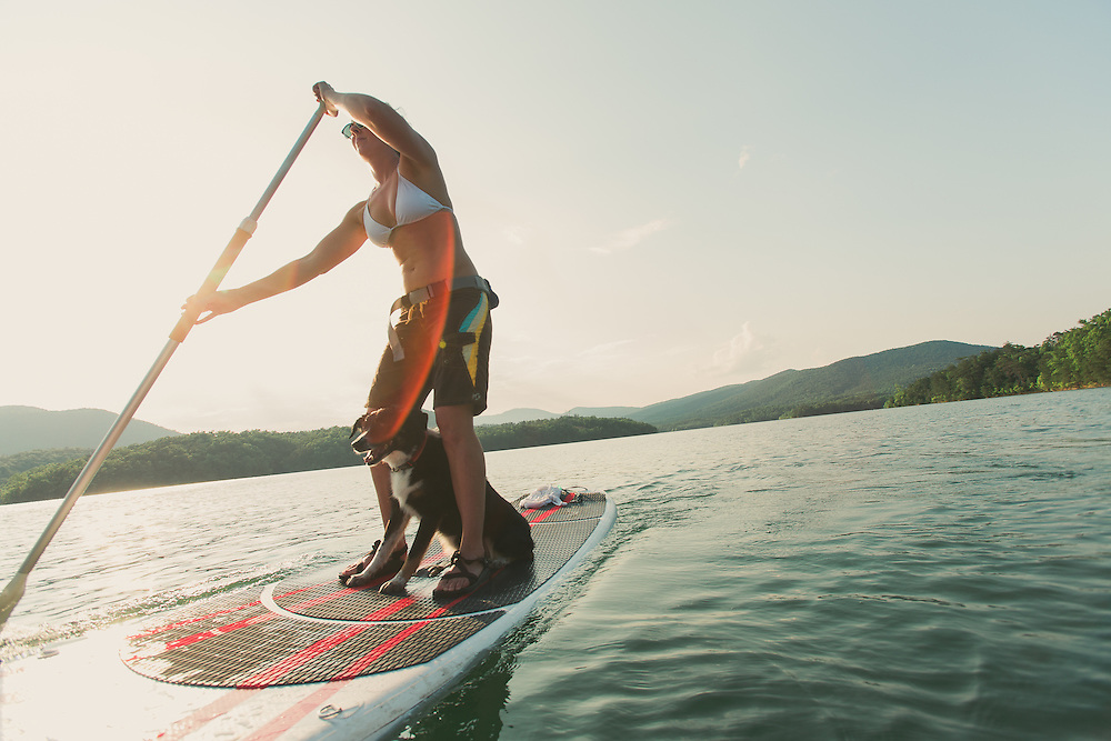 Stand up Paddle Boarding (SUP) on a lake outside Roanoke, Virginia, in the Blue Ridge Mountains. Women woman hiking, biking, backpacking, adventuring, camping, paddle boarding outdoors,
