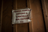 A banner on a door asking to keep it closed. Brontallo (Switterland) July 01, 2014. Beñat and Nathalie spend two months (July and August) on Spulüi, at 1.900 meters, taking care of goats and making cheese. Their children Kemen (7 years old) and Oihu (18 months) are with them. (Gari Garaialde / Bostok Photo)