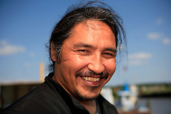 CANADA ALBERTA FORT CHIPEWYAN 21JUL09 - Chief of the Athabasca Chipewyan First Nation Allan Adam poses for a portrait by Lake Athabasca, Fort Chipewyan, northern Alberta, Canada...Adam is a vocal critic of the rapidly developing  tarsands industry and accuses the government in complicity and complacency with regards to rising levels of pollution of the air and water downstream from the tarsands sites, culminating in a high rate of rare cancer deaths in his community...jre/Photo by Jiri Rezac / GREENPEACE..© Jiri Rezac 2009