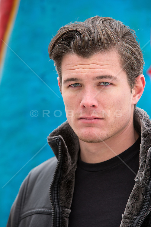 portrait of a a rugged good looking man with blue eyes and brown hair