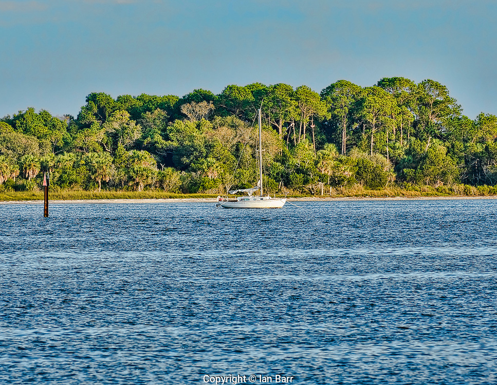 Sailboat anchored off of Cedar Key, Florida.
