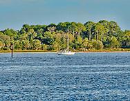 Sailboat anchored off of Cedar Key, Florida.