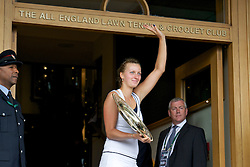 LONDON, ENGLAND - Saturday, July 2, 2011: Petra Kvitova (CZE) shows off the trophy to fans outside the Centre Court clubhouse after winning the Ladies' Singles Final on day twelve of the Wimbledon Lawn Tennis Championships at the All England Lawn Tennis and Croquet Club. (Pic by David Rawcliffe/Propaganda)