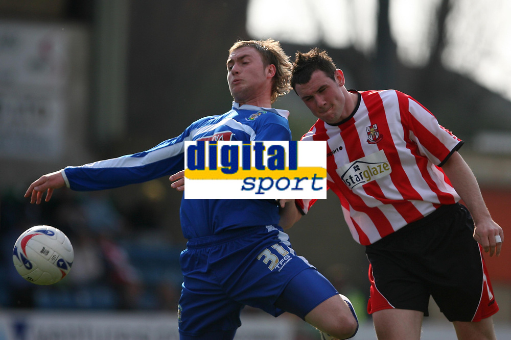 Photo: Pete Lorence.<br />Lincoln City v Stockport County. Coca Cola League 2. 07/04/2007.<br />Adam Proudlock and Lee Beevers battle for the ball.
