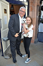 DAVID MELLOR his daughter ALI MELLOR and their dog Luli at The Dog's Trust Awards announcement held at George, 87-88 Mount Street, London on 27th March 2012.