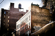May 5, 2014 - New York, NY. Twin ghost signs on 28th Street west of Sixth Avenue. 05/05/2014 Photograph by Kevin R. Convey/NYCity Photo Wire.