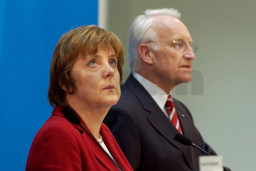 02 APR 2004, BERLIN/GERMANY:<br /> Angela Merkel (L), CDU Bundesvorsitzende, - schaut in die Luft - und Edmund Stoiber (R), CSU, Ministerpraesident Bayern, waehrend einem Pressestatement zu dem vorangegangenem europapolitischen Spitzengespraech von CDU und CSU, Konrad-Adenauer-Haus<br /> IMAGE: 20040402-02-004<br /> KEYWORDS: Ministerpr&auml;sident, CDU Bundesgeschaeftsstelle, sieht nach oben