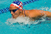 Woman swimming butterfly stroke (close-up)