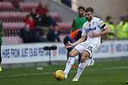 Leeds United midfielder Stuart Dallas (15) during the EFL Sky Bet Championship match between Wigan Athletic and Leeds United at the DW Stadium, Wigan, England on 4 November 2018.