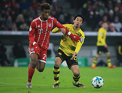 MUNICH, Dec. 21, 2017  Bayern Munich's Kingsley Coman (L) vies with Dortmund's Shinji Kagawa during a German Cup 3rd round match between Bayern Munich and Borussia Dortmund, in Munich, Germany, on Dec. 20, 2017. Bayern Munich won 2-1 and advanced into quaterfinals. (Credit Image: © Philippe Ruiz/Xinhua via ZUMA Wire)