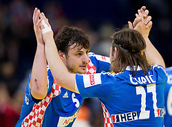 Domagoj Duvnjak of Croatia and Ivan Cupic of Croatia celebrate after the handball match between Croatia and Spain for 3rd place game at 10th EHF European Handball Championship Serbia 2012, on January 29, 2012 in Beogradska Arena, Belgrade, Serbia.  Croatia defeated Spain 31-27 and won 3rd place. (Photo By Vid Ponikvar / Sportida.com)