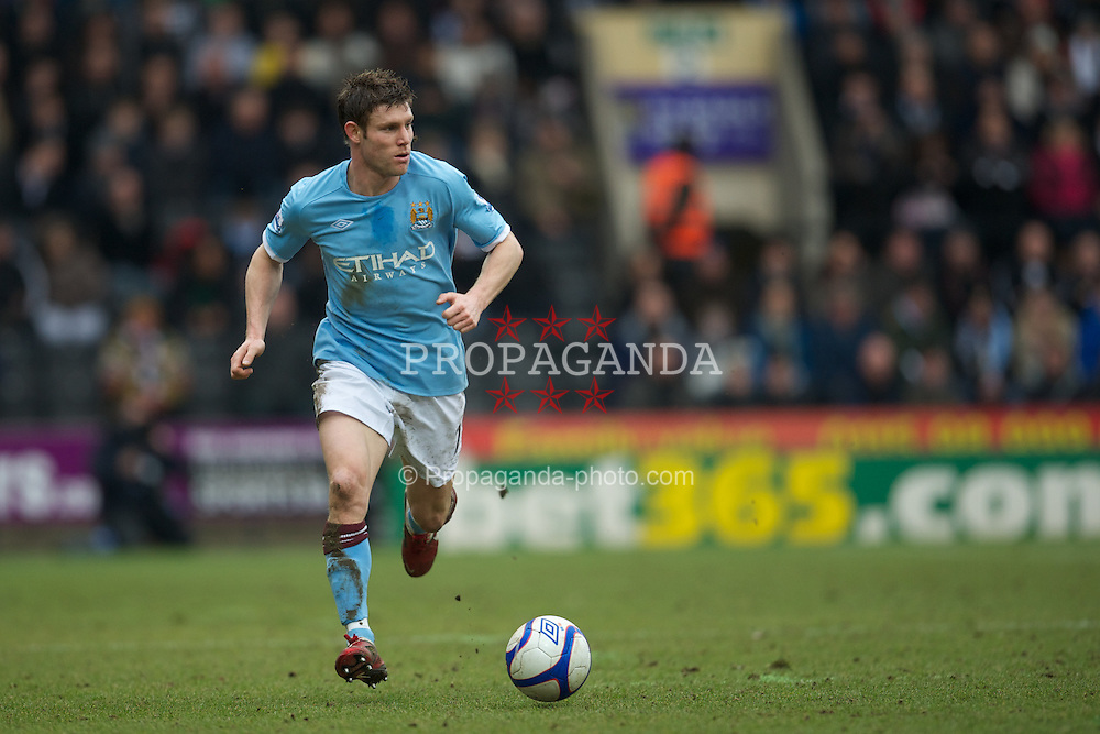 NOTTINGHAM, ENGLAND - Sunday, January 30, 2011: Manchester City's James Milner in action against Notts County during the FA Cup 4th Round match at Meadow Lane. (Photo by David Rawcliffe/Propaganda)