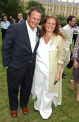 P Y GERBEAU and LADY FALCONER OF THOROTON at the annual House of Lords v House of Commons tug of war match in aid of  of  Macmillan Cancer Relief on 21st June 2005.  A drinks reception was held in College Gardens followd by the tug of war on Victoria Tower Gardens, London.                                 <br />