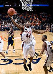 Virginia guard Sean Singletary (44) grabs a rebound against Drexel.  The #23 Virginia Cavaliers men's basketball team defeated Drexel Dragons 72-58 at the John Paul Jones Arena in Charlottesville, VA on November 20, 2007.