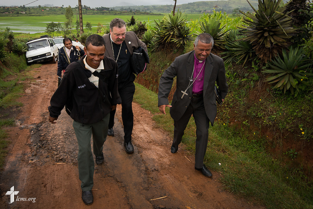 LCMS President Rev. Dr. Matthew C. Harrison walks toward a Lutheran church near Antsirabe, Madagascar, on Wednesday, Feb. 5, 2014, after a vehicle became stuck in the mud. LCMS Communications/Erik M. Lunsford