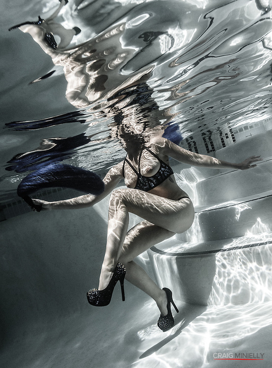 Woman in Shiny Blue Topless Bikini, in graphic semi BW Underwater pose with High Heels<br /> <br /> Underwater Beauty by Craig Minielly