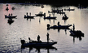 Fisherman stand in their boats in the Three Forks Harbor in Muskogee, OK, as the National Anthem is played before the start of competition in the Bassmaster Central Open fishing tournament.