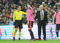 Football - 2016 / 2017 World Cup Qualifier - Group F: England vs. Scotland<br /> <br /> Scotland Manager Gordon Strachan is told to move back by the linesman at Wembley.<br /> <br /> COLORSPORT/ANDREW COWIE