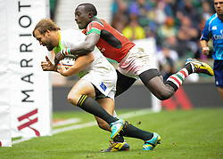 Frankie Horne (L) of South Africa with a Kenyan on his back during the Plate final match between South Africa and Kenya at the Marriott London Sevens rugby tournament being held at Twickenham Rugby Stadium in London as part of the HSBC Sevens World Series,  Sunday, 11th May 2014. Picture by Roger Sedres / i-Images
