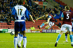WIGAN, ENGLAND - Tuesday, March 16, 2010: Aston Villa's James Milner shoots against Wigan Athletic during the Premiership match at the DW Stadium. (Photo by David Rawcliffe/Propaganda)