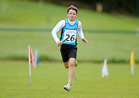 13 Aug 2016: Liam Fitzgerald, from Dublin, heads for the line in the U12 Mixed Distance relay.  2016 Community Games National Festival 2016.  Athlone Institute of Technology, Athlone, Co. Westmeath. Picture: Caroline Quinn