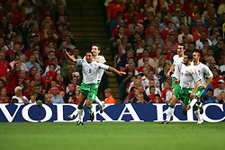 CARDIFF, WALES - Wednesday, September 8, 2004: Northern Ireland's Jeff Whitley celebrates scoring the opening goal against Wales with team-mate David Healy during the Group Six World Cup Qualifier at the Millennium Stadium. (Pic by David Rawcliffe/Propaganda)