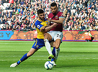 Football - 2018 / 2019 Premier League - West Ham United vs. Southampton<br /> <br /> Ryan Fredericks of West ham challenges Shane Long, at The London Stadium.<br /> <br /> COLORSPORT/ANDREW COWIE