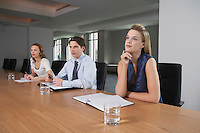 Three businesspeople sitting at conference table