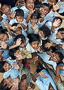 Students attending the local public school before attending the 'Stepping Stones' school in Siem Reap, Cambodia.