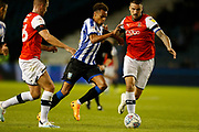 Jacob Murphy of Sheffield Wednesday dribbles passed Sonny Bradley of Luton Town during the EFL Sky Bet Championship match between Sheffield Wednesday and Luton Town at Hillsborough, Sheffield, England on 20 August 2019.