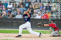 KELOWNA, BC - JULY 16: Marvcus Guarin #16 of the Kelowna Falcons swings through after hitting the ball against the the Wenatchee Applesox  at Elks Stadium on July 16, 2019 in Kelowna, Canada. (Photo by Marissa Baecker/Shoot the Breeze)