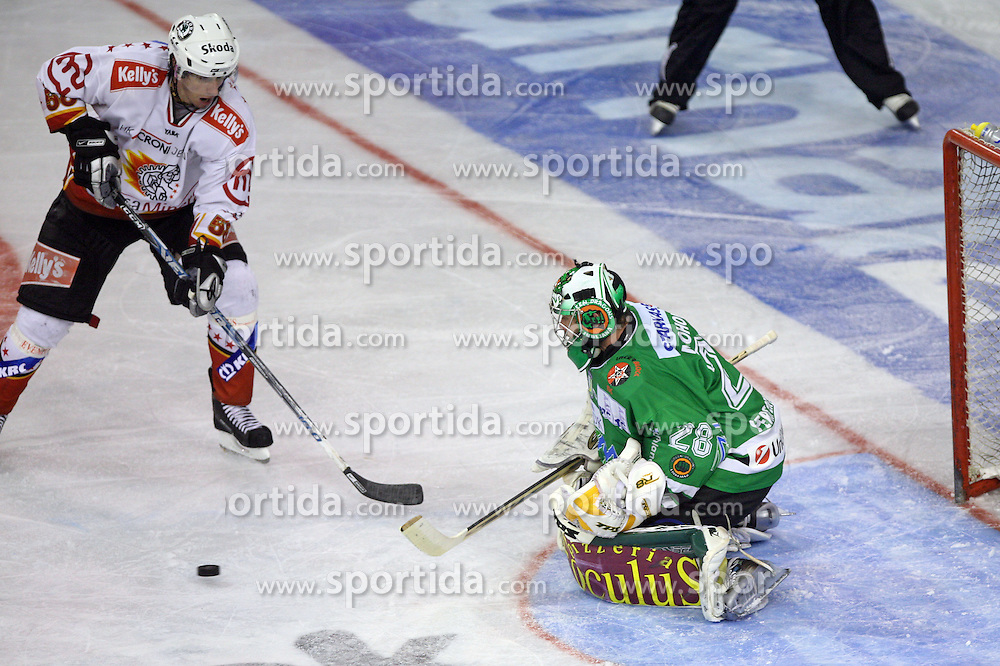 Derek Bekar of Jesenice infront of Klemen Mohoric of Olimpija at ice hockey match ZM Olimpija vs  Acroni Jesencie in third round of final of Slovenian National Championship,  on April 8, 2008 in Arena Tivoli, Ljubljana, Slovenia. Acroni Jesenice won the game 1:2 and lead the series 3:0.  (Photo by Vid Ponikvar / Sportal Images)