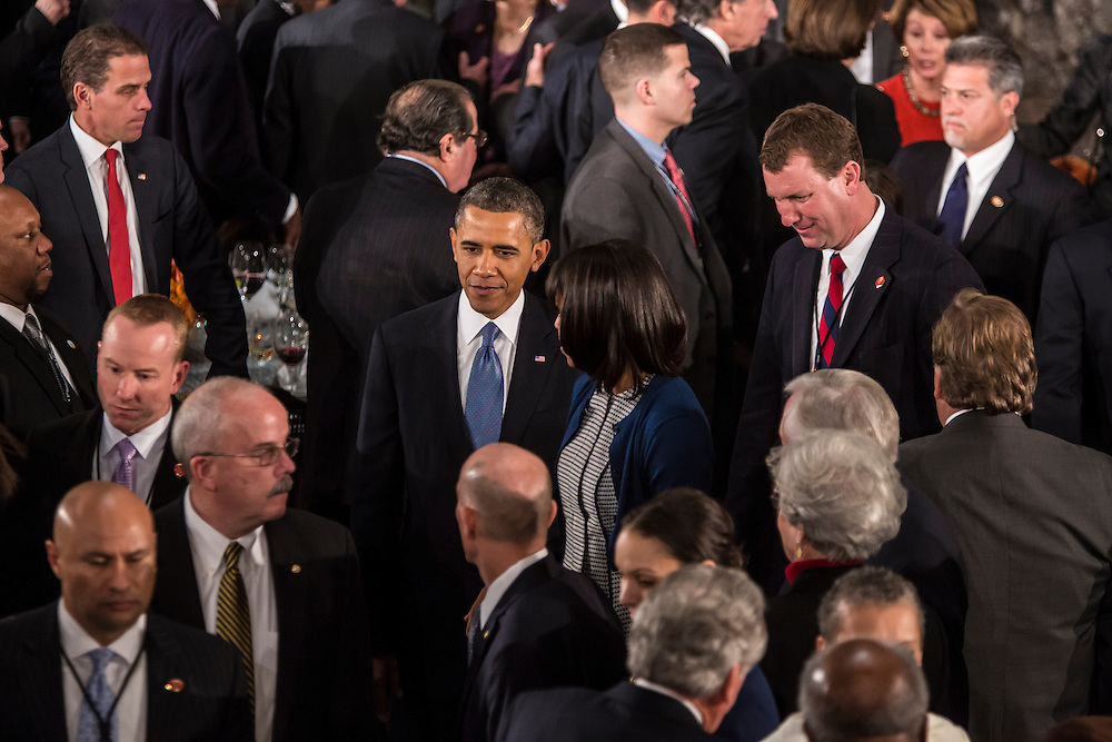 President Barack Obama and First Lady Michelle Obama depart the Inaugural Luncheon in Statuary Hall at the U.S. Capitol on Monday, January 21, 2013 in Washington, DC.