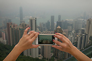 View of Hong Kong from Victoria Peak on the screen of an iPhone 6. November 2015. Photograph © 2015 Darren Carroll