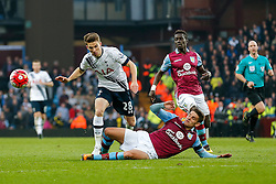 Tom Carroll of Tottenham Hotspur is tackled - Mandatory byline: Rogan Thomson/JMP - 13/03/2016 - FOOTBALL - Villa Park Stadium - Birmingham, England - Aston Villa v Tottenham Hotspur - Barclays Premier League.