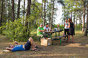 Resting in camp before supper, Hudson Bay Regional Park, end of Day 6.