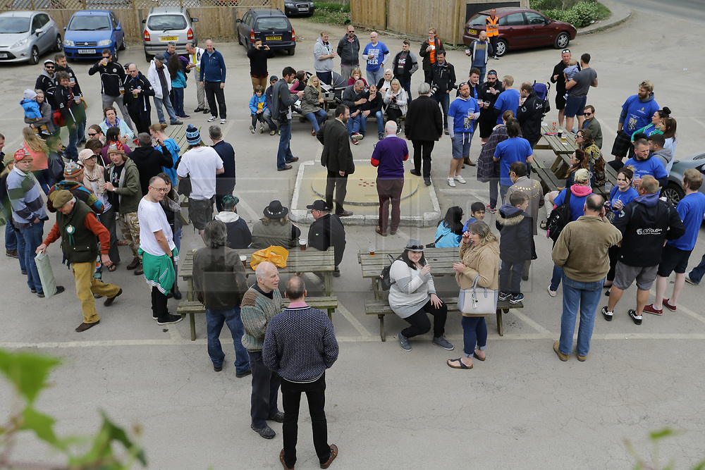 © Licensed to London News Pictures. 14/04/2017. Tinsley Green, Crawley, Sussex UK. Annual marble championships 2017 held at the Greyhound pub in Crawley for the  shoot out for marble geeks. Charlwood Strikers(blue tops) v Rolling Drunks. Competitor come from all over the world to compete.  Photo credit: Grant Melton/LNP