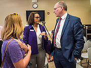 15 JULY 2019 - DES MOINES, IOWA: JOHN BESSLER, right, husband of Senator Amy Klobuchar (D-MN) talks to voters after a Klobuchar campaign event in Des Moines. Sen. Klobuchar hosted a roundtable on issues important to older Americans at a community center in Des Moines. Klobuchar is running to be the Democratic candidate for President in the 2020 election. Iowa hosts the first event of the Presidential election cycle. The Iowa Caucuses are on February 3, 2019.         PHOTO BY JACK KURTZ